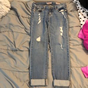 Low rise, straight leg, ripped, light wash jean